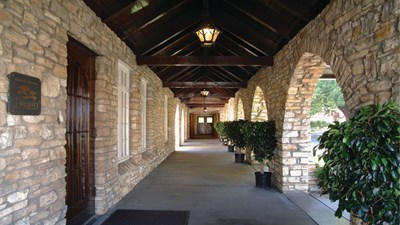 Stone archways and rich, mahogany beams greet guests at Rose Hills Alhambra.