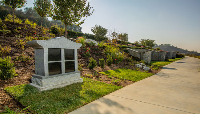A niche estate along a beautifully landscaped pathway. Lotus Cremation Trail at Rose Hills Memorial Park.